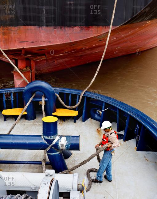 Tugboat crew member working