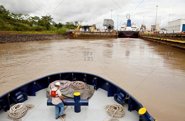 Tugboat crew member in Panama Canal