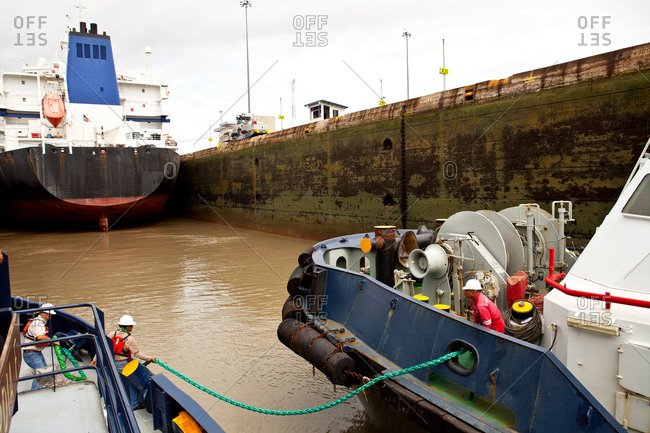 Crews of tugboats passing through Panama Canal