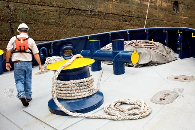 Tugboat passing through Panama Canal locks