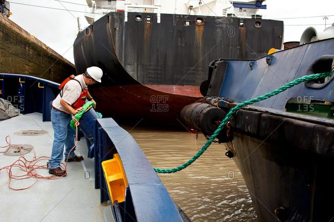 Tugboat crew securing lines - Offset