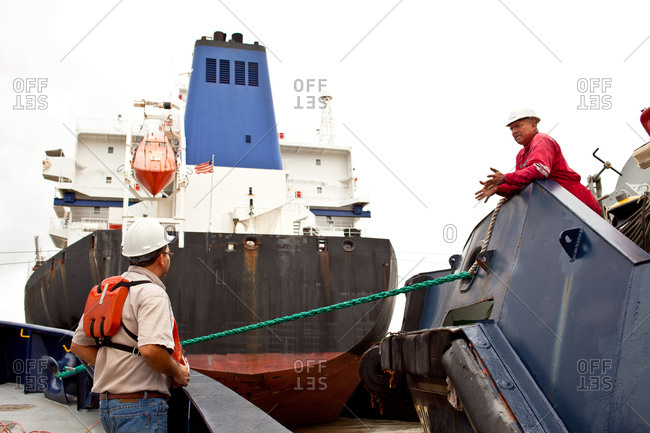 Tugboat crewmen communicating - Offset Collection