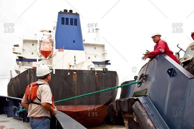 Tugboat crewmen communicating