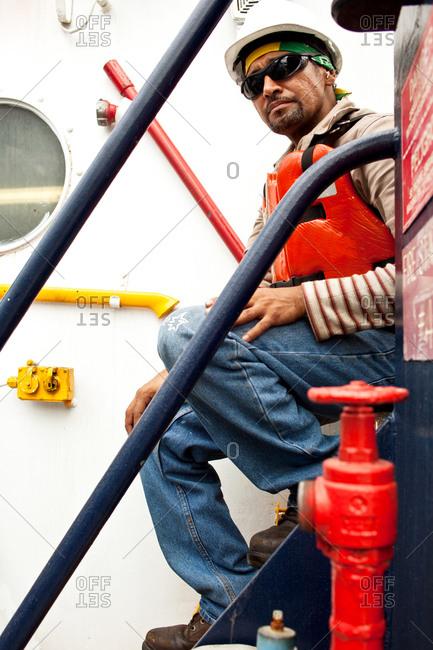 Tugboat crew member on tugboat