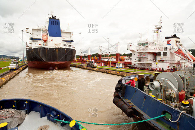 Tugboats and crew passing through Panama Canal locks