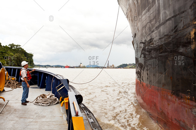 Cargo and tug boats in Panama Canal