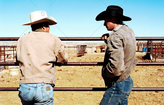 Two cowboys talking in ranch