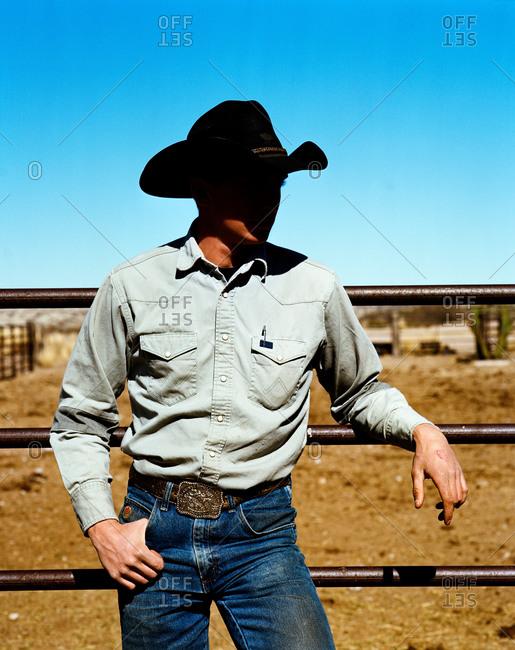 Cowboy by corral