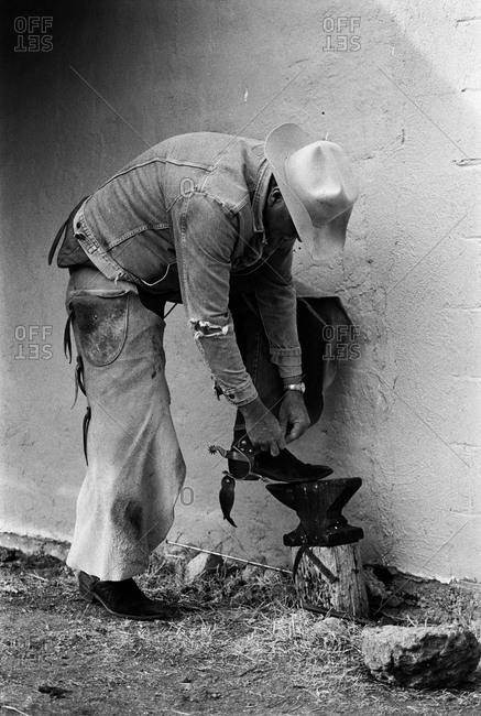 Man adjusting his spurs