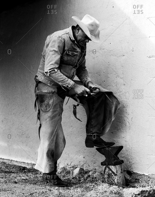 Man adjusting spurs