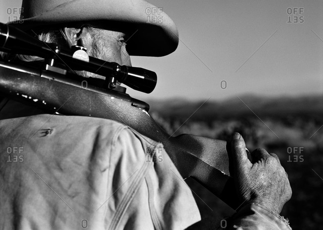 Cowboy with rifle on shoulder