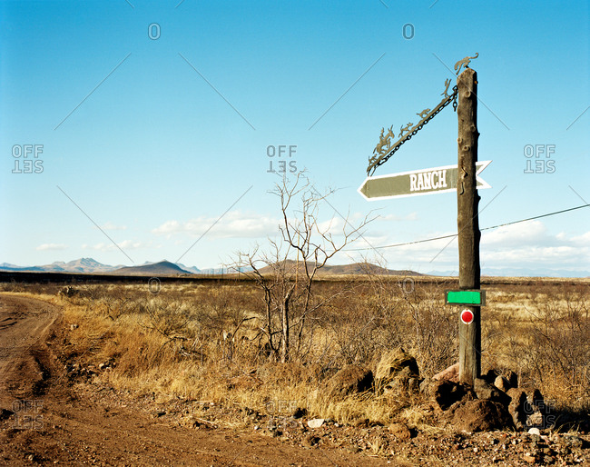Ranch sign by dirt road