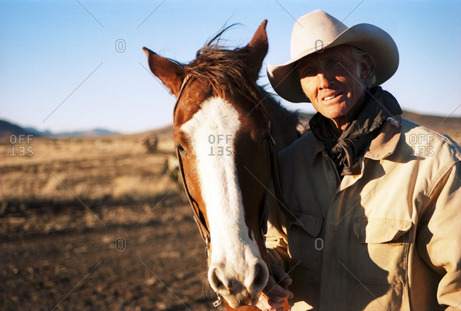 Cowboy next to horse