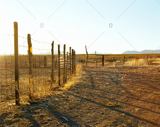 Fence post and gate on ranch in desert