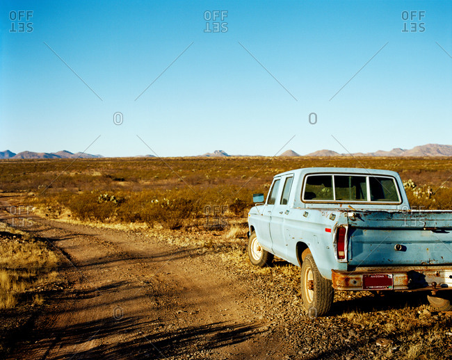 Truck parked on dirt road in plains