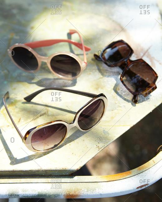 Sunglasses on a metal table