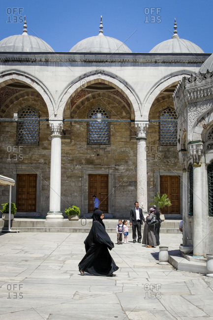 Istanbul, Turkey - May 26, 2011: People going about their day in front of the the New Mosque