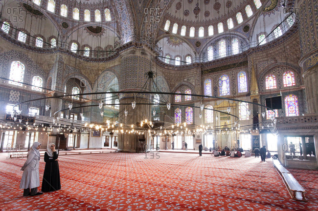 Istanbul, Turkey - May 27, 2011: People standing inside the Blue Mosque
