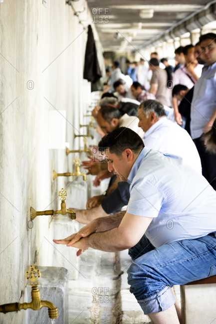 Istanbul, Turkey - May 27, 2011: Men washing their hands before prayer in the Blue Mosque