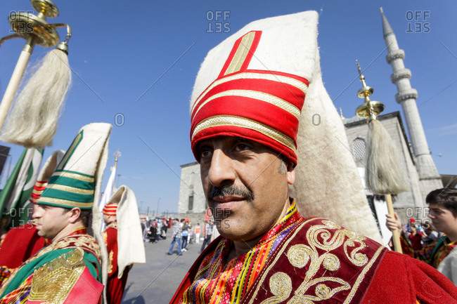 Istanbul, Turkey - May 30, 2011: Participant in a celebration in front of the New Mosque