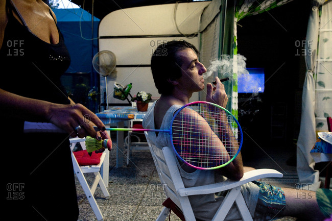 Torre del Lago, Italy - August 9, 2009: A man smokes in a folding chair at a camp site