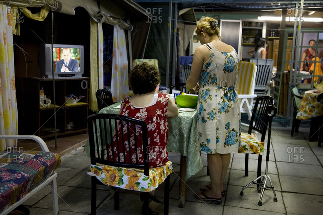 Torre del Lago, Italy - August 9, 2009: Woman prepares food at a camp site