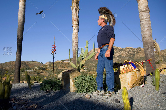 San Diego, California, USA - February 2, 2009: A Native American stands in the desert