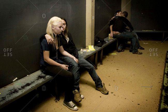 Bologna, Italy - May 1, 2008: Two couples engage with each other in a back room of a bar