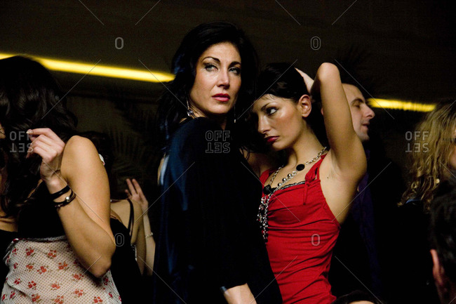Florence, Italy - February 13, 2008: Two women dance together