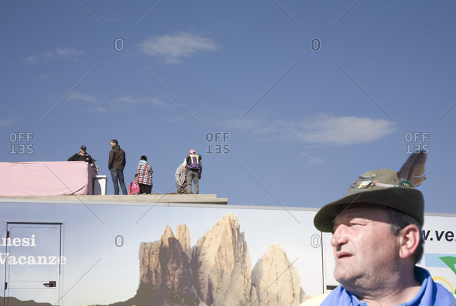 Monte Zoncolan, Italy - May 23, 2010: A man in an Alpine hat stands in front of a trailer
