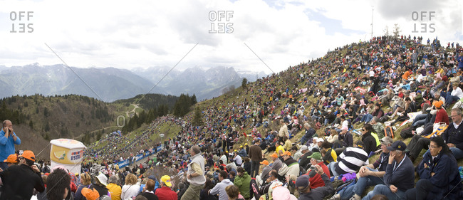 Monte Zoncolan, Italy - May 23, 2010: Spectators wait for a bike race to pass by on a hillside, Giro d'Italia