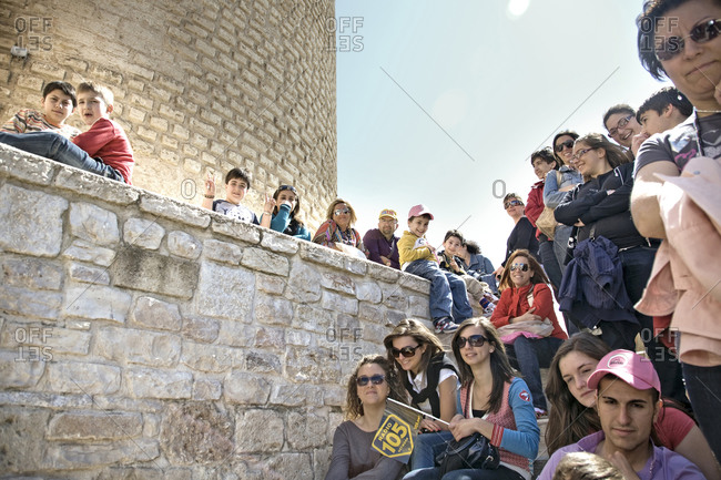 Bitonto, Italy - May 18, 2010: Crowds sit on stairs waiting to watch the cyclists, Giro d'Italia
