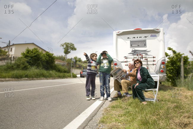 Lucera, Italy - May 19, 2010: A family waits for cyclists to pass by their location, Giro d'Italia