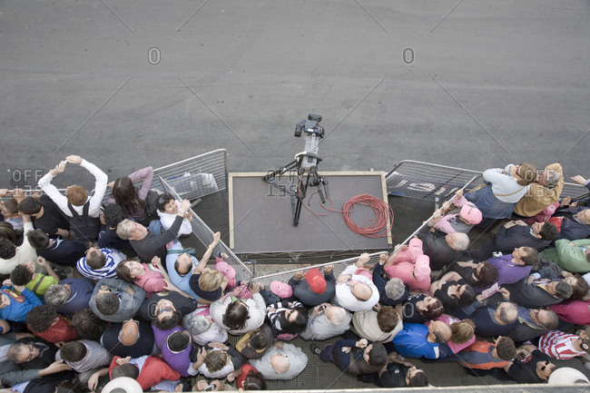Bitonto, Italy - May 18, 2010: Crowds press against a fence while waiting for cyclists to pass, Giro d'Italia