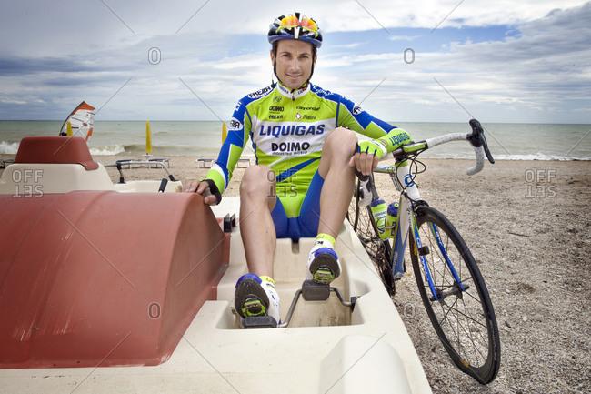 Giro d'Italia, Italy - May 21, 2010: Cyclist, Ivan Basso, sits in a paddleboat, Giro d'Italia