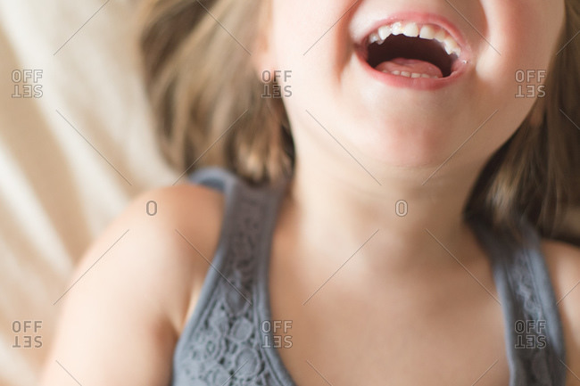 Close up of a laughing little girl