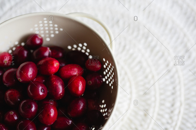 Close up of fresh cranberries in a colander
