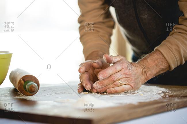 Close up of elderly man making pasta