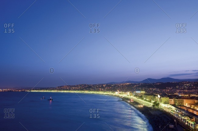 Promenade Des Anglais beach at dusk in Nice, France