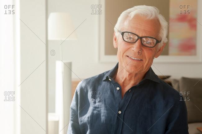 Portrait of smiling senior man wearing glasses