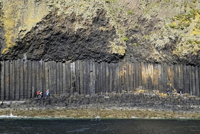 Argyll and Bute, Scotland, UK - September 19, 2014: Basalt columns and volcanic ash on Staffa island