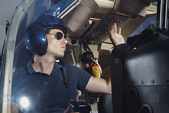 Helicopter pilot in cockpit