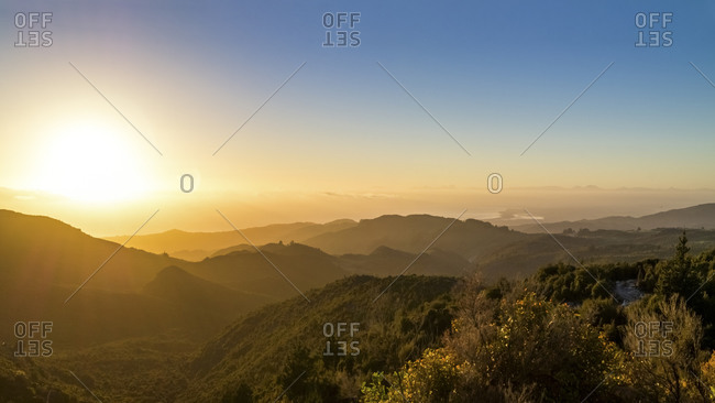 Sunrise above the ocean seen from mountains