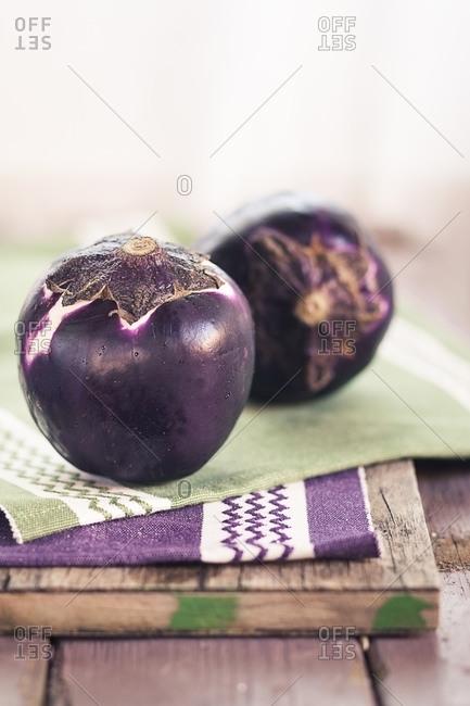 Two eggplants, Solanum melongena, on a tray