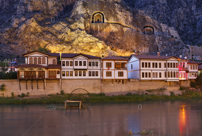 Ottoman houses and rock tombs at river Yesilirmak, Turkey