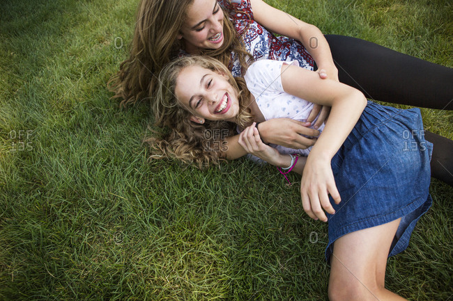 Two girls laying in the grass