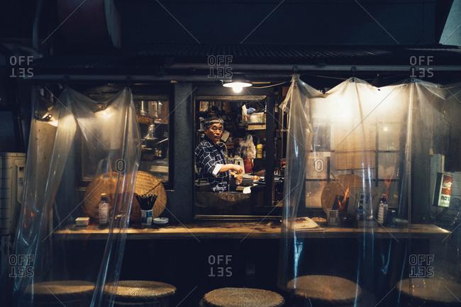 Tokyo, Japan - January 4, 2014: Chef at a small food stall