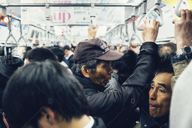 Tokyo, Japan - March 28, 2014: Crowd in a commuter train