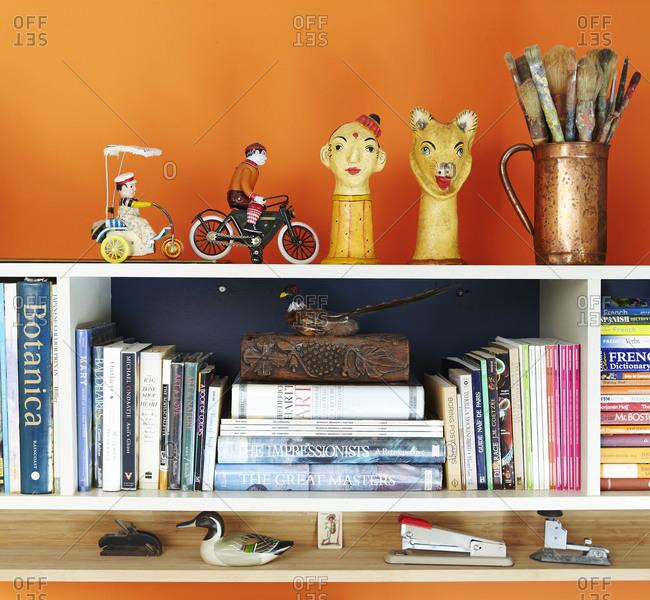 Orange wall with shelf