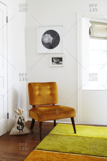 Orange chair in bedroom